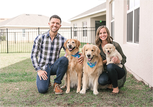 family with golden retrievers